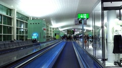 FPV move at travelator, BCN terminal interior at early morning, departure gates Stock Footage