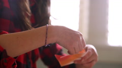 Close up of a girl's hands as she folds origami paper at home Stock Footage