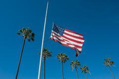 Flag lowered to half-mast - stock photo