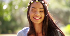 Mixed Race Woman with flowers in hair smiling in camera Stock Footage