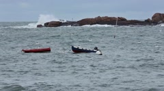 Two Boats on Sea Waves. Pink Granite Coast, France. Stock Footage