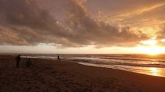 Family on Sunset Sea Sandy Beach. Stock Footage