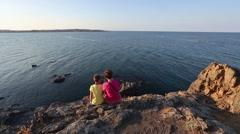 Family on Rocky Sea Coast. Stock Footage