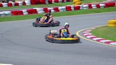Two go carts round a bend at Phuket Kart, a popular attraction Stock Footage