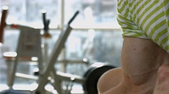 Man buiding up muscles with dumbbells. Stock Footage