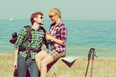 Couple backpacker tramping by seaside Stock Photos