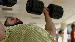 Sportsman working out in gym. Stock Footage