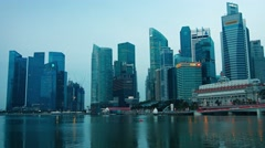 Glass skyscrapers and Singaporean icon Merlion in early morning light Stock Footage