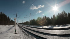Freight train with electric locomotive at the head rushes on winter railroad Stock Footage