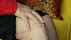 Closeup of an Old Woman Massaging Her Knee Stock Footage