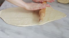 Chef rolling dough with rolling pin. Stock Footage