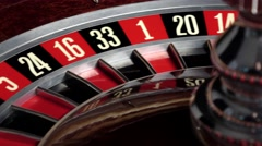 Roulette wheel starts running and stops with white ball Stock Footage