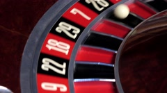 Roulette wheel running and stops with fallen white ball Stock Footage