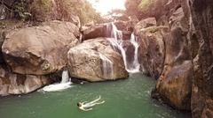 Happy tourist swims in Ba Ho Waterfall near Nha Trang, Vietnam Stock Footage