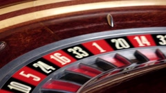 Roulette wheel running and stops with white ball on 33 Stock Footage