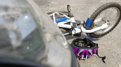 Car and bicycle road accident - stock footage