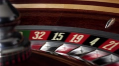 Usual roulette wheel running with white ball, side view Stock Footage