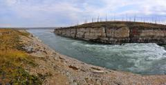 Panorama of rapid in a rocky canyon. - stock photo