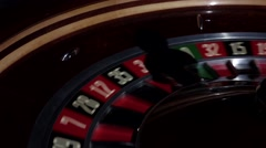 Usual roulette wheel running with fallen white ball, shadow, close up Stock Footage