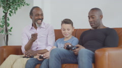 4K 3 Male generations of happy family playing video games together at home Stock Footage