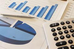 Office desk with charts , histograms and financial documents Stock Photos