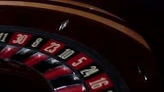 Part of roulette wheel running, numbers, close up Stock Footage