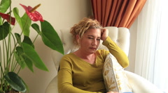 Sleepiness, yawning woman watching television Stock Footage