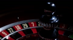 Roulette wheel running and stops with white ball on 2 Stock Footage