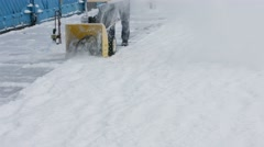 Janitor cleans snow tractor. Stock Footage
