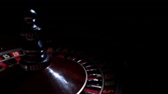 Roulette wheel fast running with white ball on 23, cam moves to the right, black - stock footage