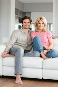 Couple on sofa, portrait - stock photo