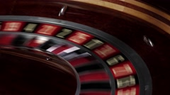 One part of roulette wheel starts running, numbers, close up Stock Footage
