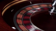 One part of fast running wheel roulette, white ball falls, close up Stock Footage