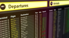 Departures sign board with flight information, destination cities on timetable Stock Footage
