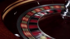 One part of fast running wheel roulette, white ball falls on 22, close up Stock Footage