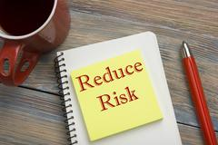 Risk management strategies - avoid, exploit, transfer, accept, reduce, ignore Stock Photos