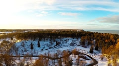 Winter landscape. Aerial footage. Sunset. River and sea coast. Stock Footage