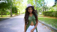 Portrait of pretty Asian Indian girl in hipster clothes updating her video diary Stock Footage