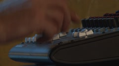 Hand boosts the audio mixing console Stock Footage