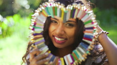 Portrait pretty Asian Indian girl at outdoor festival smiling for video diary Stock Footage