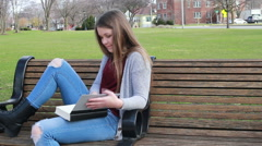 Young girl flipping through a book, video - stock footage