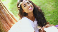 Portrait of Indian Asian female wearing floral headband for video diary - stock footage