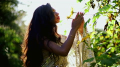 Stock Video Footage of Portrait of serene ethnic Indian girl in shaddi dress outdoors