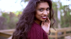 Portrait of ethnic Indian girl in sweater dress and boots for her video diary - stock footage