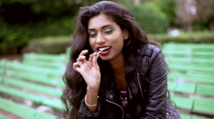 Stock Video Footage of Portrait of ethnic Indian girl in leather jacket and boots for her video diary