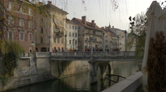 Crowded area on Cobblers Bridge in Ljubljana Stock Footage