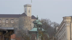 Church dome and steeple with Ljubljaba Castle in the background in Ljubljana Stock Footage