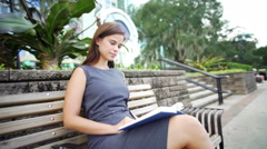 Hispanic American girl relaxing outdoors downtown with a cup of coffee - stock footage