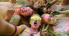 Multi-Ethnic Group Celebrating Holi Festival in Park - stock footage
