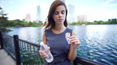 Young Hispanic girl with energy food bar and water updating her video diary Stock Footage